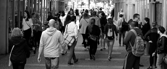 Header image of people walking in the city