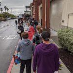 Line of people waiting outside Trader Joe's in Alameda, CA